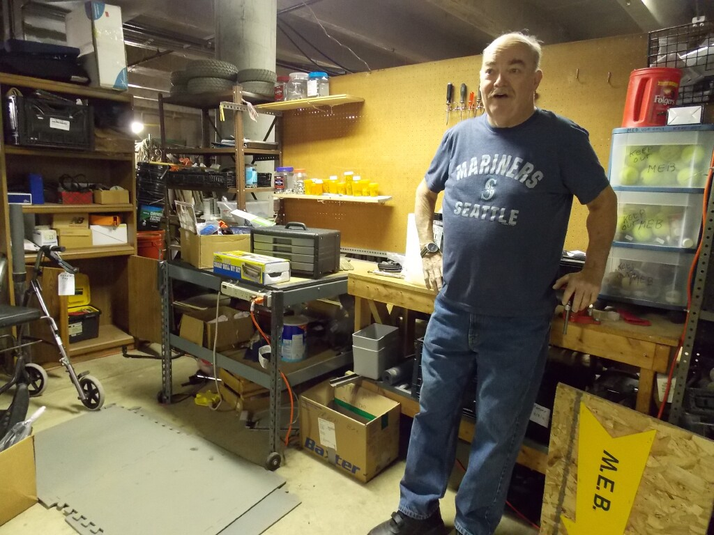 Mike Kelly, Medical Equipment Bank Coordinator, at the equipment repair workbench ...